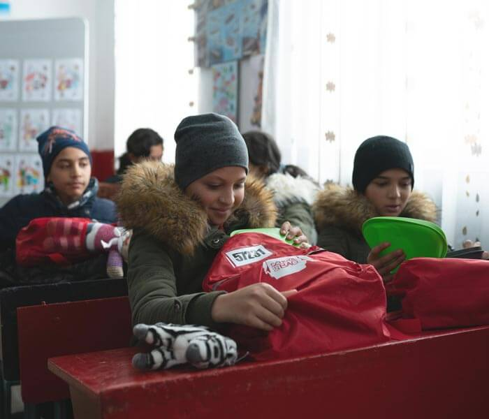Blake Distributes School Bags in Romania