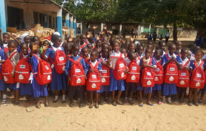 Distributing Blake's SchoolBags in The Gambia