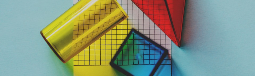 Red, yellow and blue coloured transparent blocks on a mechanical graph